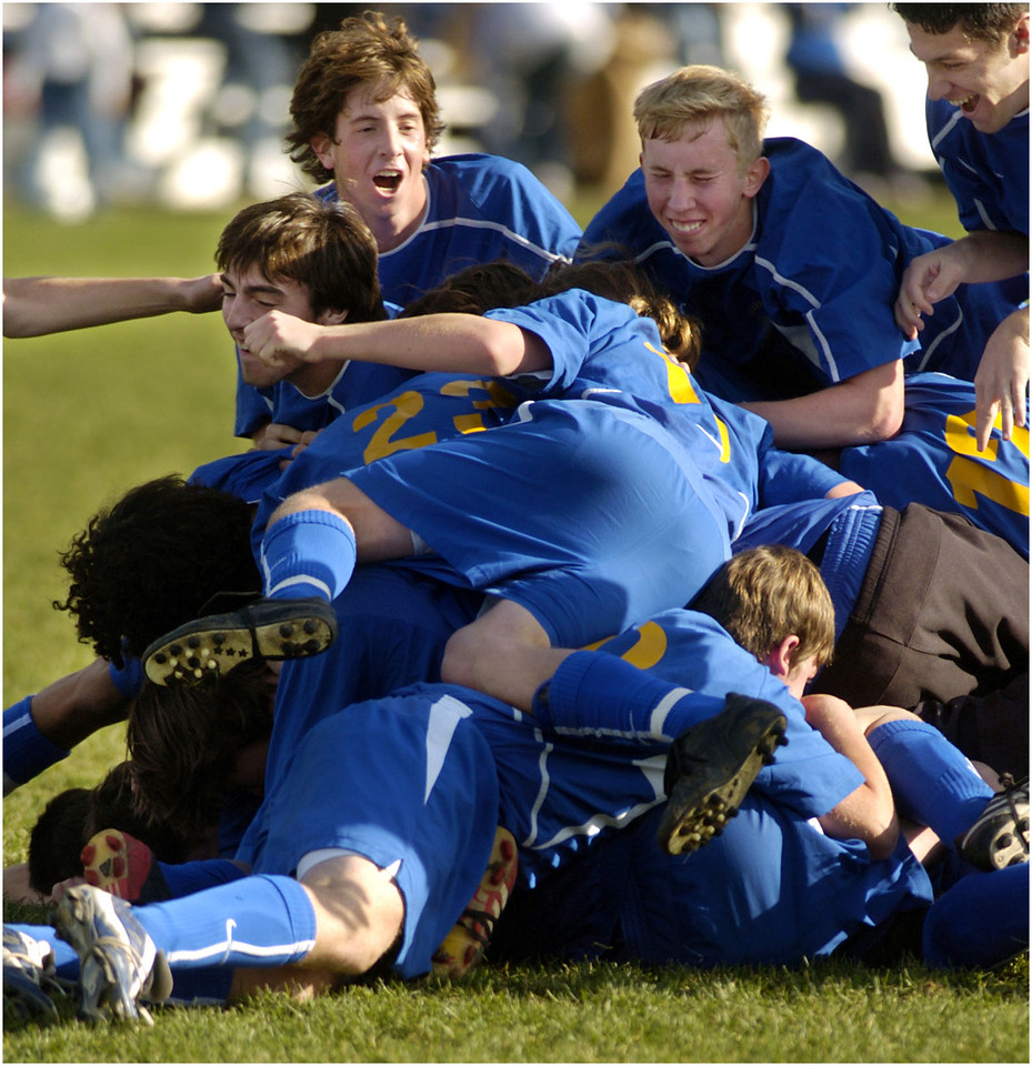 7.94x8.25deep---Ana Zangroniz photo for Bill Palmer story to run Sports, Sunday 11.7.04. Members of the Mayfield Panthers pile on top of one another in celebration over their victory over the Galway Eagles, 3-2, in the Class C soccer finals held at Colonie High School, Saturday, November 6, 2004.