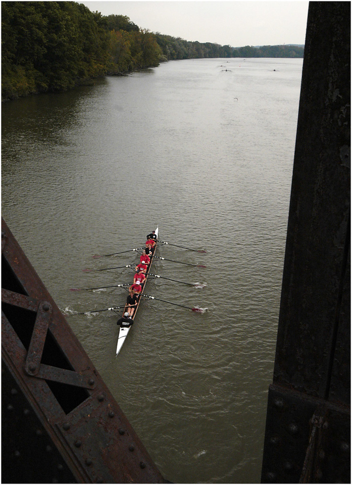7.94x11.0deep---Ana Zangroniz photo for Mary Martialay story to run Sunday 10.3.04. Just after the start of the Master's Women's Eight Race, the Aqueduct Rowing team heads downriver in hopes of claiming first place. The annual Head of the Mohawk Regatta took place on Saturday, .October 2, 2004, after a one-year hiatus. (Ana likes this pic alot :-)