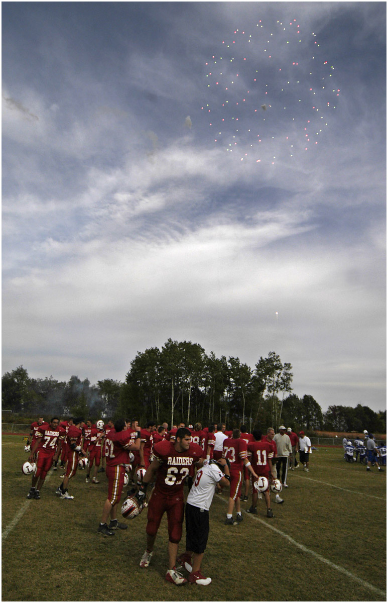 5.92x9.25deep---Ana Zangroniz photo for Jeff Wilkin story to run Sunday _____????  in Lifestyles. At the conclusion of their win against the Hoosick Falls Panthers, fireworks are ignited in celebration of the Red Raiders football team.