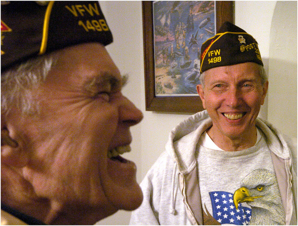 7.94x6.0deep---Ana Zangroniz photo for Pam Allen story to run Tues. 10.12.04. Calvin Thayer, left, laughs while chatting with Bob Piper and Tom Pollock (not pictured) before the start of their VFW meeting on Monday evening, October 11, 2004.