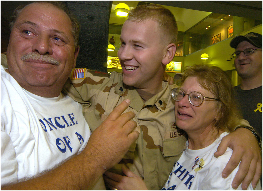 7.94x6.0deep----Ana Zangroniz photo for stand-alone use, to run 9.18.04. Tony Buchanan, center, is welcomed back to Albany by his uncle Mike Picarillo, left, and his mother Vicki Buchanan. Tony Buchanan is part of the Army's Delta Co. 1-105, Infantry Division, that has been stationed in Iraq since January. Buchanan, a Troy native, returned home for two weeks of leave on Friday, September 17, 2004.