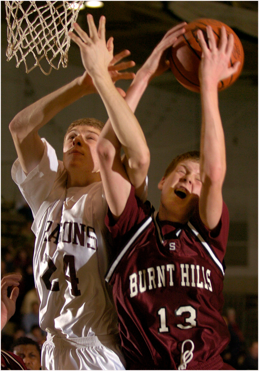 5.92x8.5deep---Ana Zangroniz photo for Mike MacAdam story, to run Sports, Monday, Feb. 21, 2005. Kevin Himmelwright of Burnt Hills (13), grabs the rebound despite the efforts of Gloversville Dragon Ryan Jarvis (24). Burnt Hills came back from a deficit of more than 20 points to win, ____, on Sunday, Feb. 20, 2005, at Hudson Valley Community College. *Ana's #1 choice*
