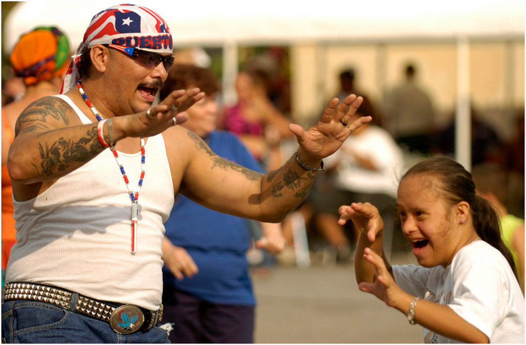 7.94x5.25deep---Ana Zangroniz photo for a Bob Conner story to run Sunday, August 21, 2005. Roberto Lopez Colon, left, of Albany, and Madelin Vazquez of Amsterdam, dance together at Centro Civico's Cultural Arts Festival, held on Main Street, Saturday, August 20, 2005.