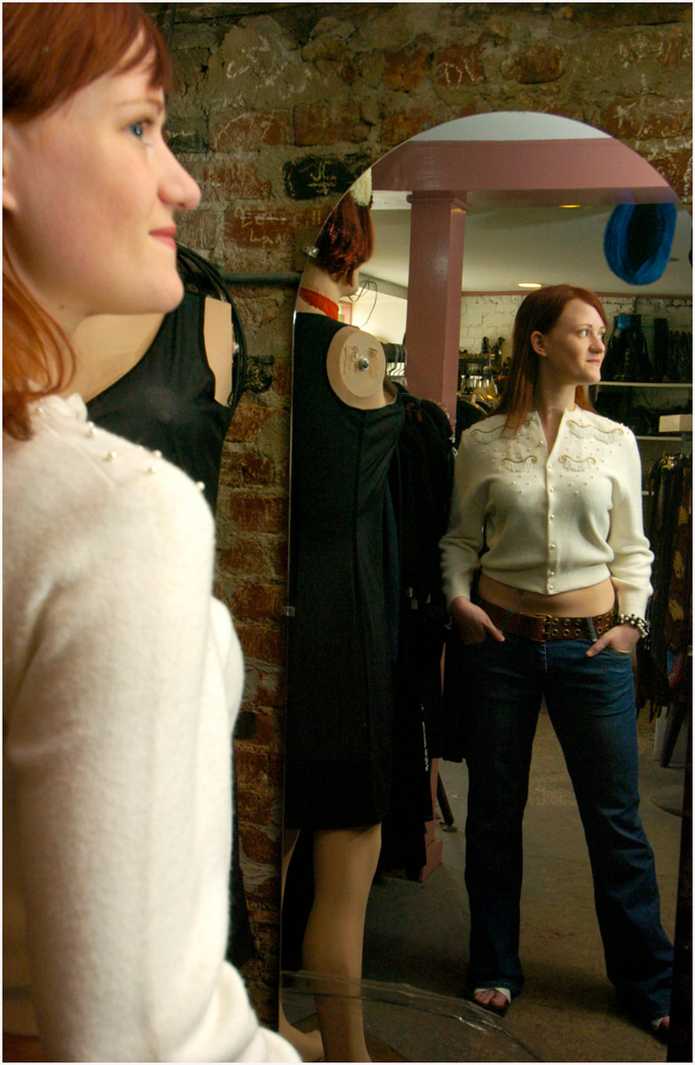 """5.92x9.0deep---Ana Zangroniz photo for a Bill Buell story to run Sunday April 10 in Lifestyles. Inside of Special FX Vintage Clothing store in Albany, Sarah Smith, a frequent customer models a """"mix 'n match"""" outfit, consisting of a Western-inspired beaded sweater from the 1950's, a beaded bracelet also from the 50's, a 1960's grommetted belt, and """"7 For All Mankind"""" brand Jeans (non-vintage). The shoes are the same 60's style stacked."""