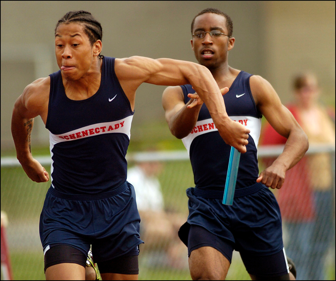 9.97x8.25deep---Ana Zangroniz photo for a Schiltz/MacAdam story to run Sports, Sunday, May 15, 2005. Joe Dixon, left, the second leg of the 4x1 relay team, receives the baton from teammate Kevin Jackson to continue the race. The Schenectady High School Men's 4x1 team placed third in the event, on Saturday, May 15, 2005. *STELLY-this my BEST photo!!! This is what I've been trying for all year! PLEASE, POR FAVOR, use it well!***~Ana :-) (can be cropped into a narrower horizontal, if needed)