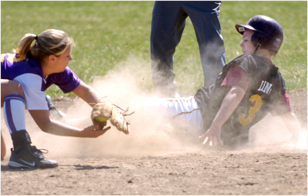 7.94x5.0deep---Ana Zangroniz photo for a Jim Schiltz story to run Sports, Wed. April 19, 2005. Despite the efforts of Amsterdam player Amanda Smith (12), Colonie's Kyla Lynch (31) steals second base. Lynch later scored the first run of the game . The game ended at a 1-1 tie after 10 innings, on Tuesday, April 18, 2005.