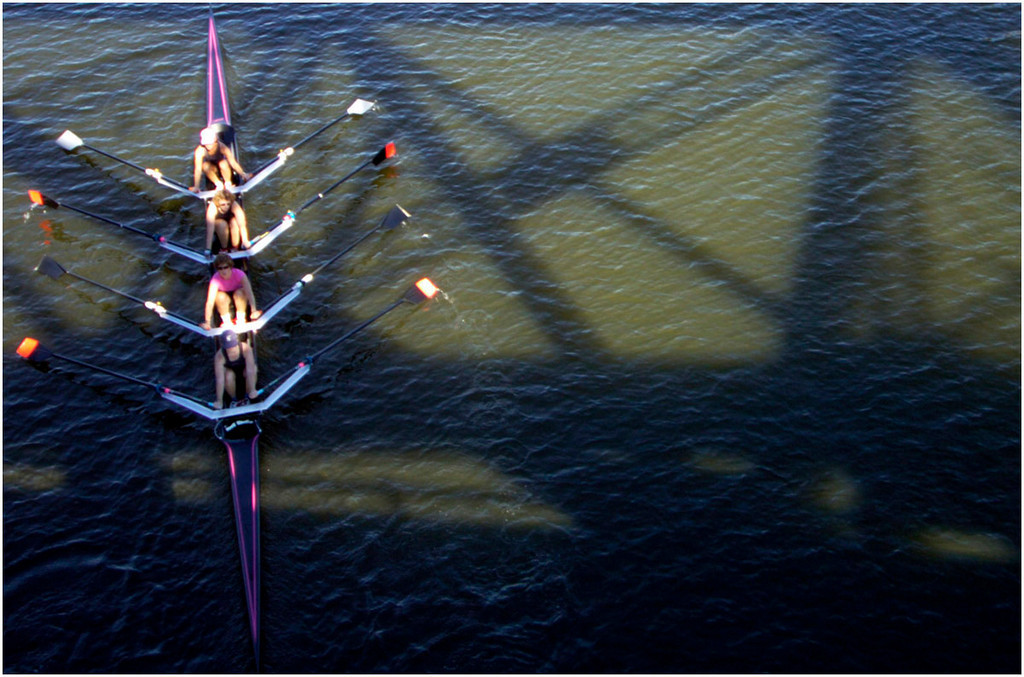 7.94x5.25deep---Ana Zangroniz photo for a Matt Volke story to run Sunday, Oct. 2, 2005. Members of the Skidmore Community Rowing club pass under the railroad bridge as they continue down the river during the annual Head of the Mohawk Regatta, on Saturday, October 1, 2005. THIS PHOTO SUGGESTED FOR DOMINANT USE BY AZ.