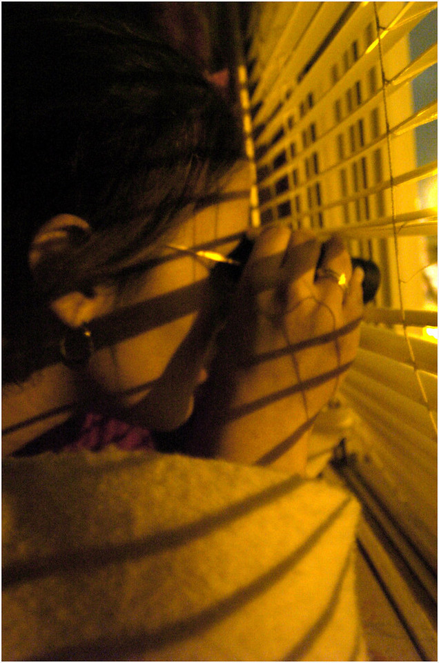 5.92x9.0deep---Ana Zangroniz photo for daily use, City section, Wed. 1.26.05. 17-year-old Lulu Rivas, a resident at 412 Paige Street, watches through her window as Schenectady Police enter 409 Paige Street, where a suspected robber was thought to be hiding. After hours of police inspection, nothing was found.
