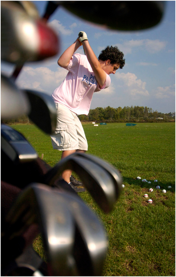 "5.92x9.25deep---Ana Zangroniz enterprise photo for stand-alone use, to run First Edition, Wed. Sept. 21, 2005. ""A Glorious Day For Golf"" Mike Hall, 17, a Senior at Fonda-Fultonville High School practices his driving skills along with his golf teammates at the 19th Hole Driving Range in Johnstown, on Tuesday, September 20, 2005. On days when the team has no matches, they go as a group to the driving range for practice."