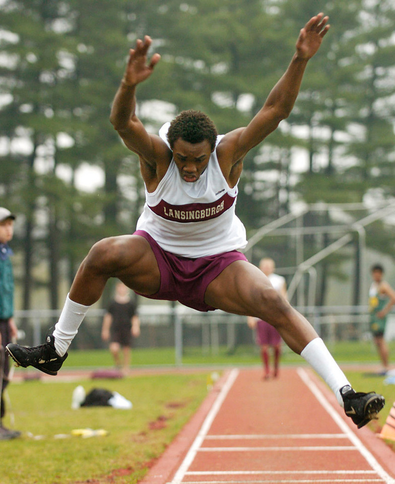 5.92x7.25deep---Ana Zangroniz photo for use in Sports, Sunday, April 24, 2005. Anthony Lynch, a Lansingburgh High School senior, launches in the air for one of his jumps, which helped him win the Triple Jump event on Saturday, April 23, 2005. *This photo suggested for dominant use, as it's quite sharp!*