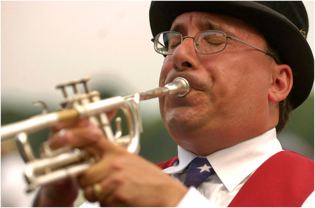 """7.94x5.25deep---Ana Zangroniz enterprise photo for stand-alone use, to run Tuesday, August 9, 2005. Sam the Bugler plays the """"Call to Post"""" before the eigth race of the day at Saratoga Race Course, on Monday, August 8, 2005."""
