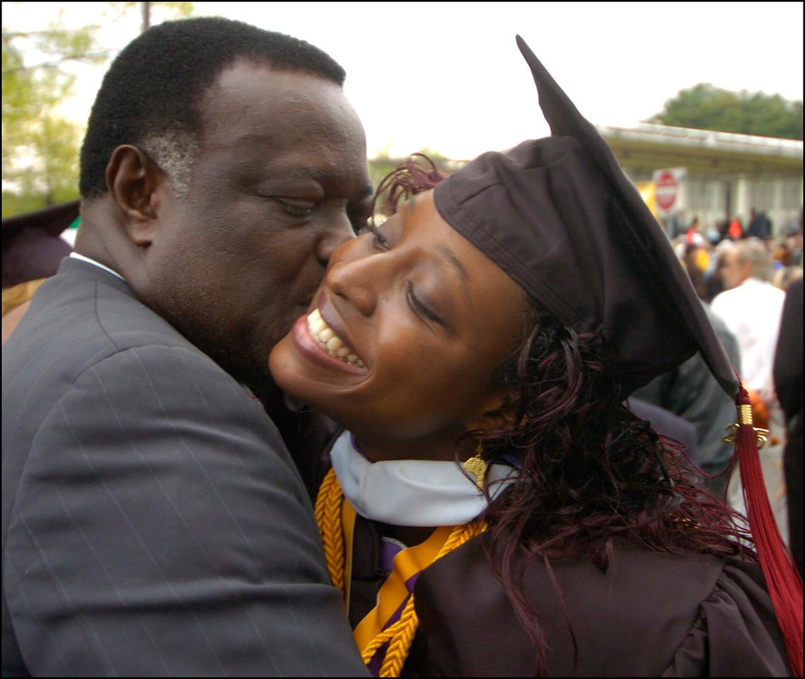 7.94x6.5deep---Ana Zangroniz photo for a Kathy Parker story to run Monday, May 16, 2005. Edwina Smith. right, of Albany, receives a congratulatory hug and kiss from her grandfather Edwin Kalikhu (cq). Smith was one of 1800 graduates who participated in the commencement ceremony on Sunday, May 15, 2005.