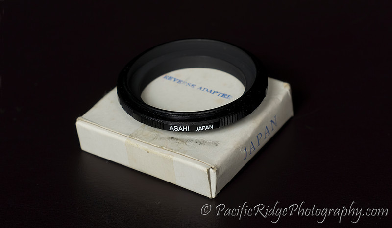 Here we have an Asahi 49mm Reversing Ring.  This adapter allows for a lens to be mounted backwards onto the camera, which will then magnify lens for macro work.