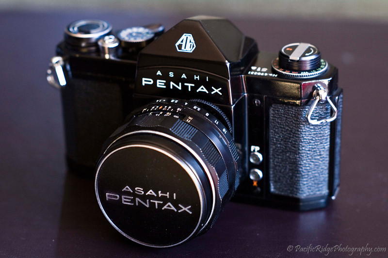 "1962 Pentax S1a.  This is the second release of the S1a, which was available from 1964 to 1968.  The version can be identified by the Orange colour of the ""R"" rewind symbol, with the first version being green.  <br /> <br /> The second release had a modification within the mount to accept the newly released Super Takumar 50/1.4, as compared with the Super Takumar 55/2 common on the first release."