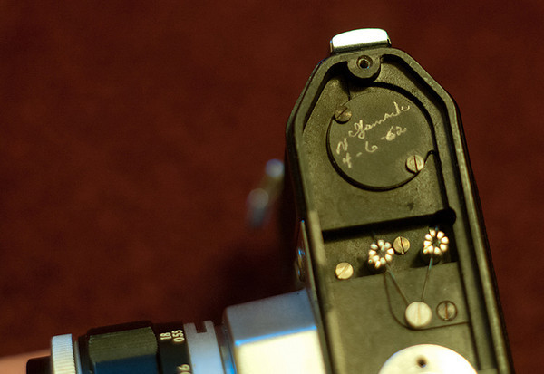 This is the bottom of the Store Demonstrator with the base place taken off. There is a signature, dated 1962. It's presumably from the original owner of the camera, that being the owner of the store.