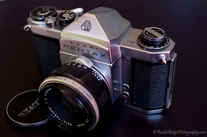 """1959 Pentax H2.  There were 2 versions of the H2 released, the first bring in 1959 and a second version in 1961 that added meter coupling.  Meter coupling can be identified by a notch being present beside the shutter speed dial, right beside the """"T"""".  So far. all of my H2s are version 1s, and this particular H2 has an extremely low serial number, presumably being from an early production run."""