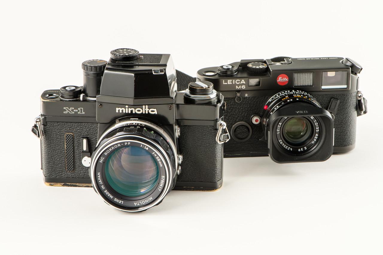 Minolta X1 (1973) and Leica m6 (1985).
