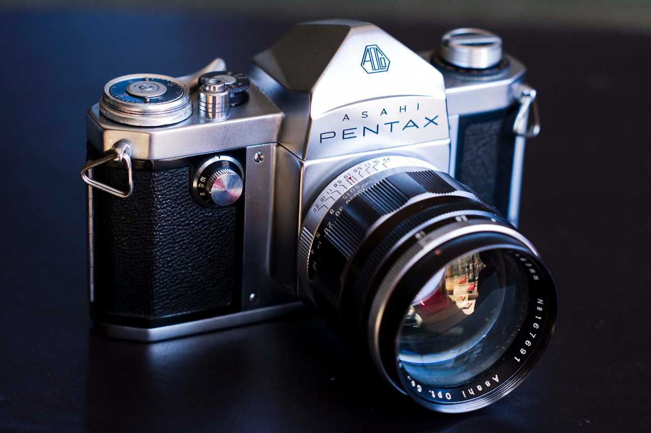 "Here is my 1957 Asahi Pentax.  This is arguably the world's first commercially successful SLR.  I say arguably because there were a few SLRs produced all the way back to 1933 with Exakta in Germany, and the better known Contax S from 1948.  <br /> <br /> The success of the Asahiflex line provided R&D capital for Asahi to develop a Pentaprism based camera and in 1957, a model named ""Pentax"" was released.  The camera was extremely well received, so much so that Asahi decided to change the company name to the one we are familiar with today; Pentax.  <br /> <br /> Other manufacturers followed with similar designs, notably the Nikon F which was released 2 years later in 1959.<br /> <br /> ."