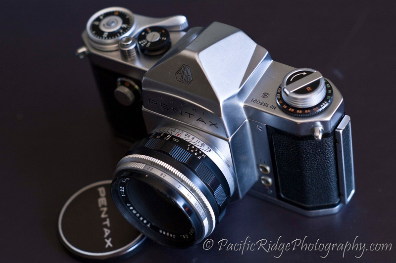 In 1958, Pentax released the S.  The main difference between the AP and the S is a change in shutter speed values to align with industry standards.  The S was not the only version of camera produced by Asahi at that time, with the more advanced K being available as well.