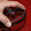 After removing the protective self adhesive film from the poly carbonate disc, it is placed into the empty filter holder and the retaining ring is screwed back with the lens tool.