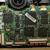 <b>E-1 IR-conversion:</b> After removal of the top plate and the back of the camera, this PCB must be lifted and folded to the side.