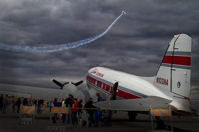 Riverside air show, dramatic clouds and two planes, dormant and active, 2011.