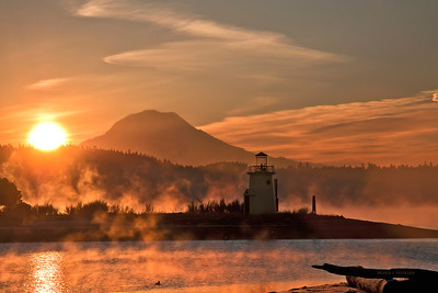 Sunrise over Mount Rainier and the Gig Harbor, Washington lighthouse January 2, 2011.