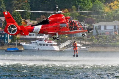2011 Blessing of the Fleet (Gig Harbor Fest), Gig Harbor, Washington.  Coast Guard HH-65C Dolphin out of US Coast Guard Air Station Port Angeles, WA dropping a swimmer in Gig Harbor demonstrating an air/sea rescue operation.