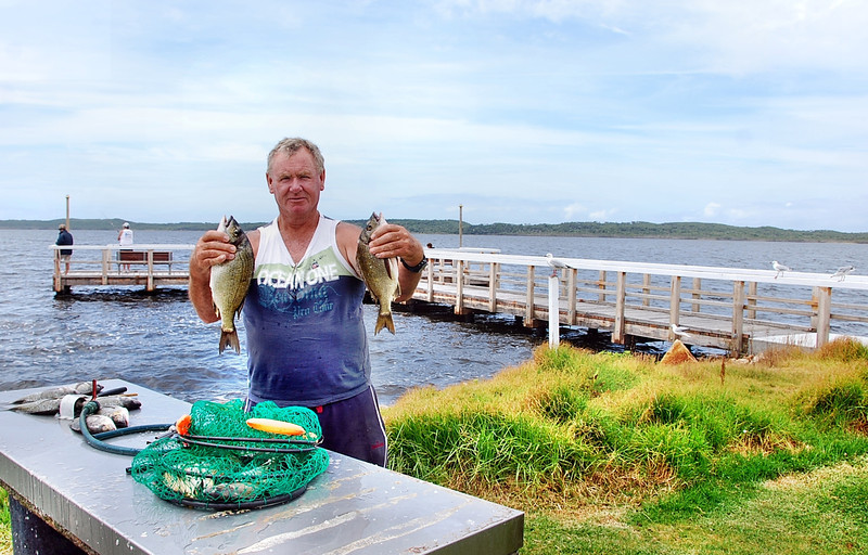 Euan Mitchell, with family catching Bream in the lake,....Platform at Bemm River in background