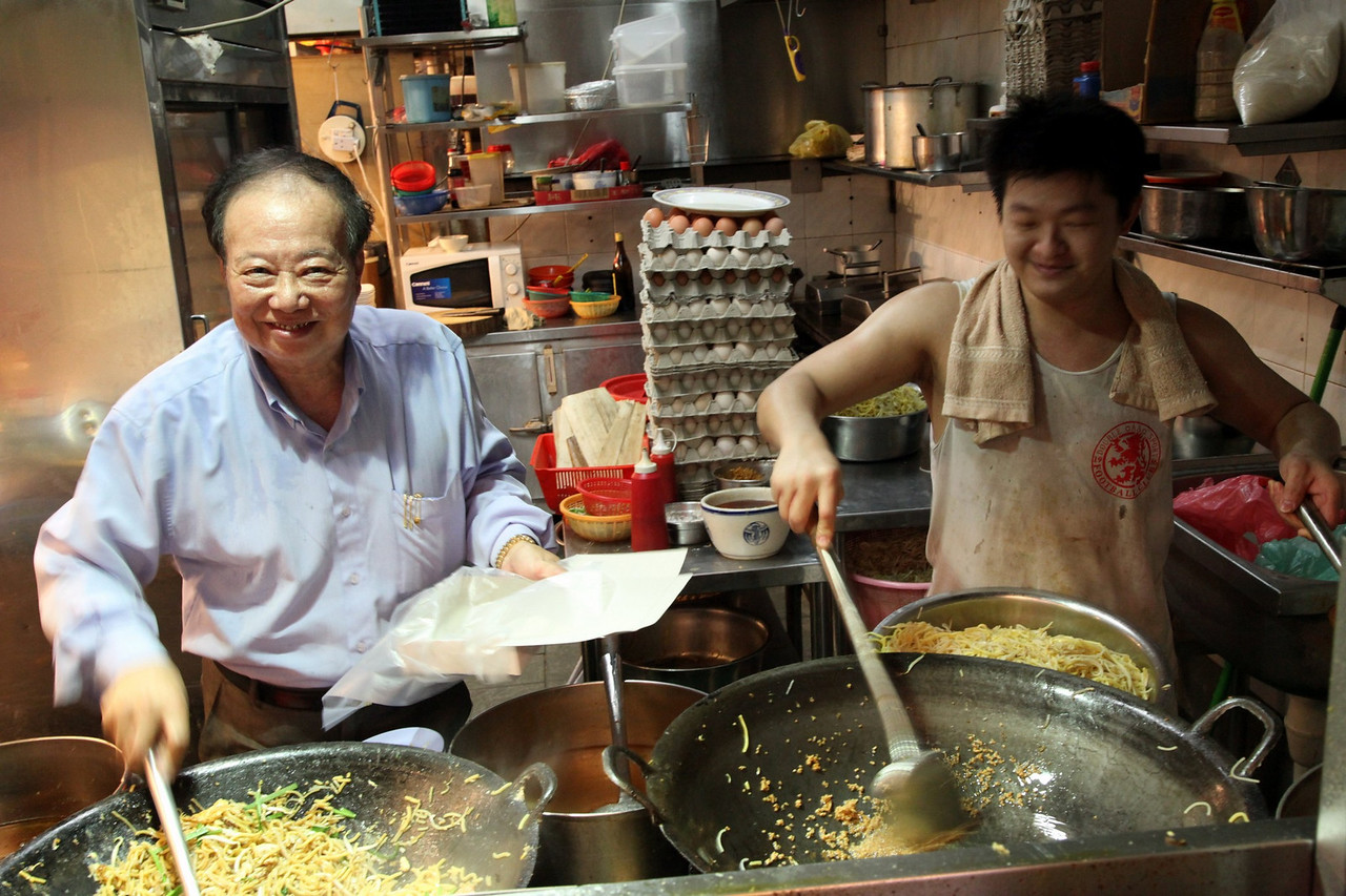 "From starting his first stall over 46 years ago, Kim's business has grown to 6 stalls located at various suburban centres across the island. His two sons joined his noodle business and they all manage two outlets each.<br /> <br /> Kim is usually found at his flagship stall in Eunos, where customers who have been with him for over 40 years often come to eat and chitchat. ""My customers, they grow old with me and my stall,"" says Kim with laughter."
