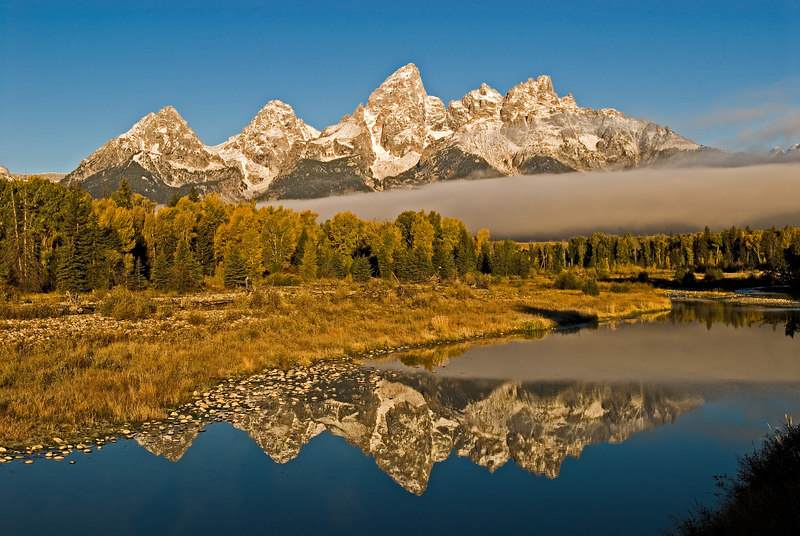Early morning shot of the Tetons at Schwabacher Landing with fog bank creeping in.
