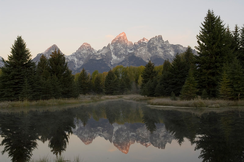 First light just barely illuminates Grand Teton Peak.  Photo by my wife, Dicksie, and Sony R1