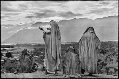 INDIA. Kashmir. Srinagar. 1948. Muslim women on the slopes of Hari Parbal Hill, praying toward the sun rising behind the Himalayas.