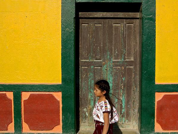 # GP 004 Girl Walking Past Door, Nebaj, Guatemala