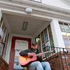 Jake Hallett a Music Teacher in Lunenburg plays his guitar on the steps of Hadwen Park Market in Lunenburg where he works part time. SENTINEL & ENTERPRISE/JOHN LOVE