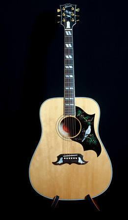1997 Gibson Dove in Flight. Number 22 of 250 made. Highly flamed maple back and sides with a deep red stain. 1 19/32nds nut.