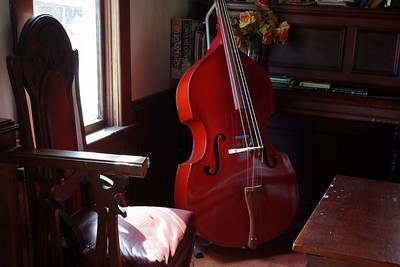 No HDR, Photoshop, only. Notice the loss of detail in the chair seat, compared to the (previous) HDR version. I played with perspective in HDR shot which is why the fiddle looks fatter in that one, but they really are the same shot, with this one being the normal exposure which was combined with the under and over exposed pixels in the HDR shot.