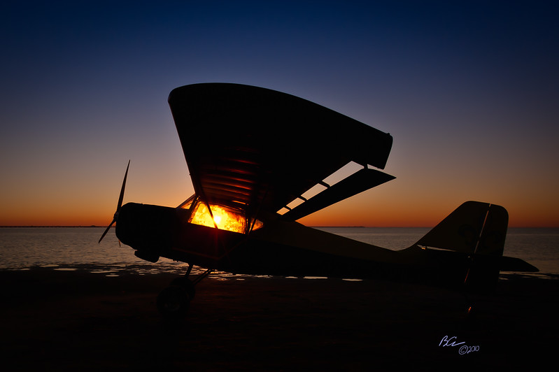 "~Great Ball of Fire!~<br /> Kitfox on Fort DeSoto Beach bringing on the sunrise.  <br /> <br /> The photographs from this photo shoot are being donated to the Aviation Explorer's Youth program.  This plane was built by teenagers from the Birmingham group.  This plane is being raffled off at this year's Sun N Fun.  To see how you can learn more about helping tomorrow's aviators, to see more of the photo shoot and to get your chance to win this beautiful plane visit:  <a href=""http://www.birminghamaviationexplorers.org/"">http://www.birminghamaviationexplorers.org/</a><br /> <br /> I'm a huge fan of Photographer, author of over 50 (probably 60 by now), world renowned lecturer, rock star (can't wait to see them perform live this at Photo Shop World), etc., etc., etc. and Photoshop Guru, Scott Kelby made the following critique of this photo:  ""ABSOLUTELY AWESOME!!!! ;) REALLY NICELY DONE -- Congrats!""  <br /> <br /> Thank you for stopping by."