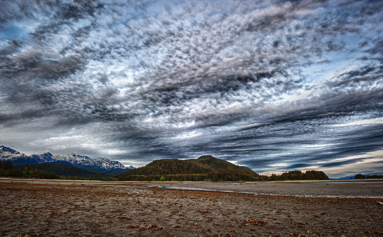 A 7 EV HDR Photograph at Eagle Beach near Juneau Alaska with neat clouds during sunset.  Taken with a Nikon d700, edited in HDR Efex Pro & Lightroom.