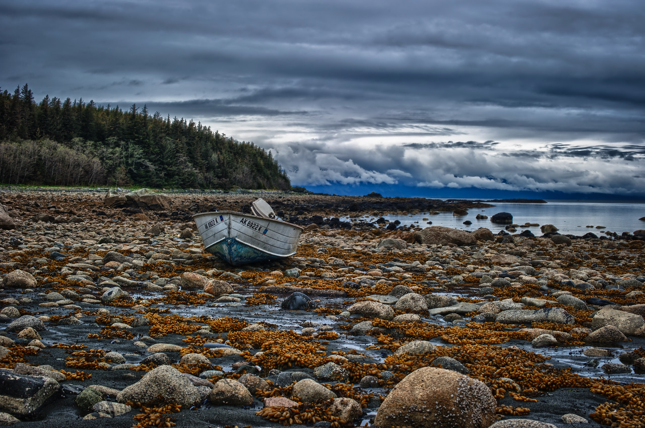 A 7 EV HDR Photograph of a skiff waiting for the tide to again rise, taken near Blue Mussel Beach near Juneau Alaska.  Shot with a Nikon d700, edited in HDR Efex Pro & Lightroom.