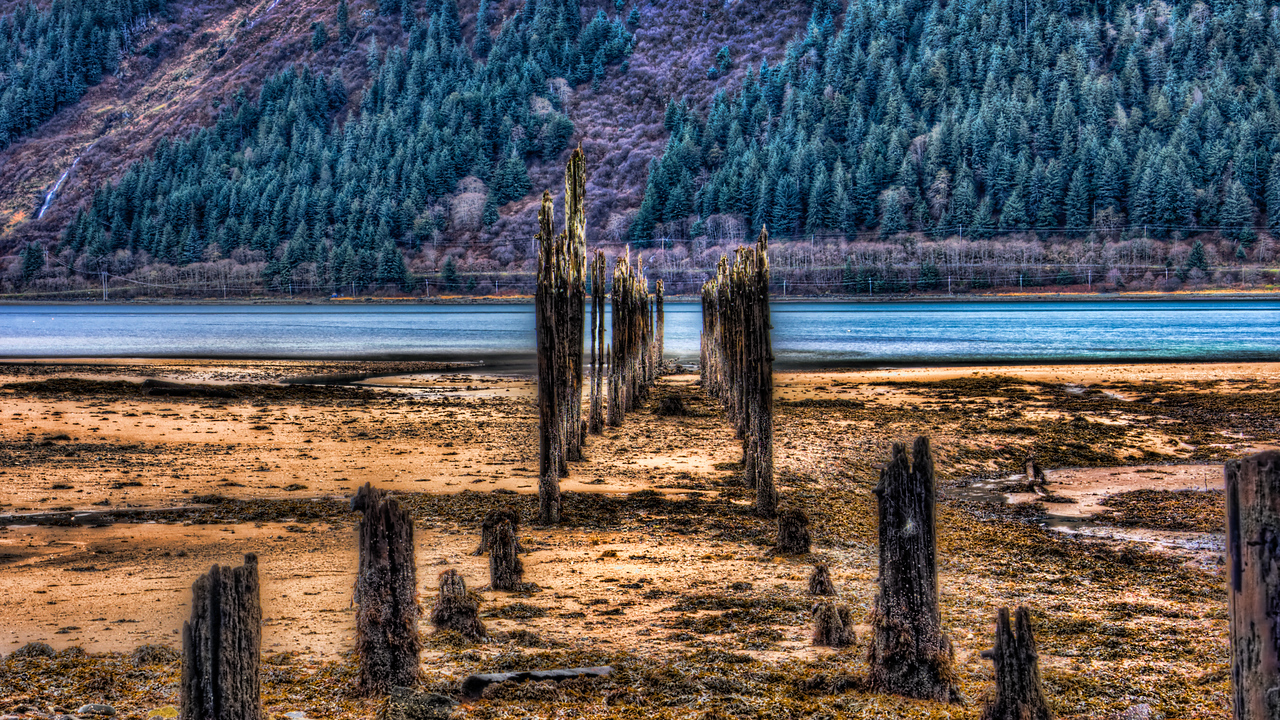 A 9 EV HDR photograph taken at Sandy Beach on Douglas Island Alaska near Juneau Alaska looking 'through' remnants of the Treadwell Gold Mine , across the Gastineau Channel at the Base of Mt. Roberts.  Shot with a Sony Alpha a300, edited in Photomatix, Topaz Adjust & Lightroom.
