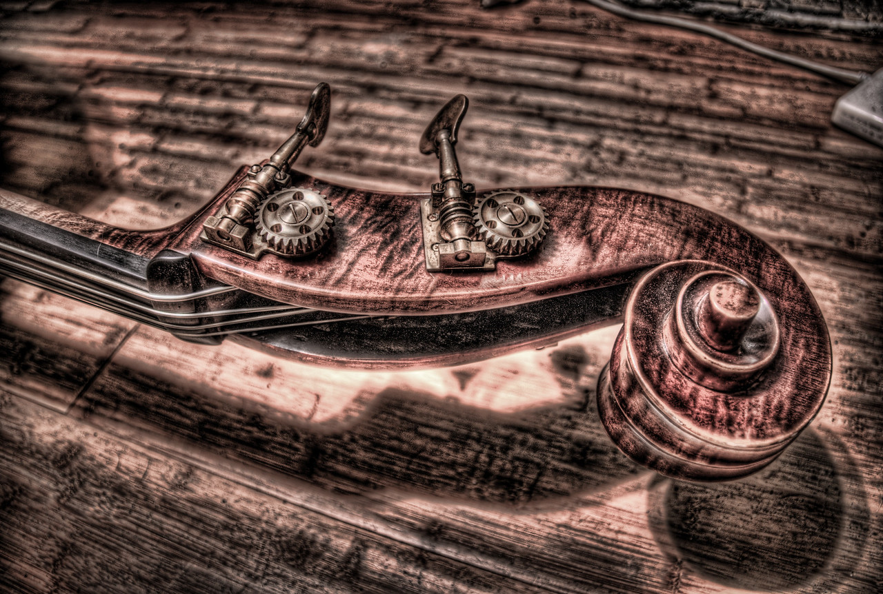 A 9 EV HDR photograph taken of the scroll of a Double Bass, shot with a Sony Alpha a300, edited in Photomatix, Topaz Adjust & Lightroom.