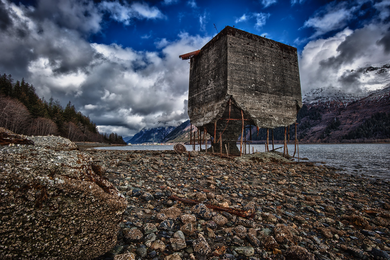 A 7 EV HDR Photograph of remnants of the historic Treadwell Gold Mine on Douglas Alaska, near Juneau Alaska.  The Gastineau Channel is visible on the right & Juneau is just beyond.  Taken with a Nikon d700, edited in HDR Efex Pro & Lightroom.
