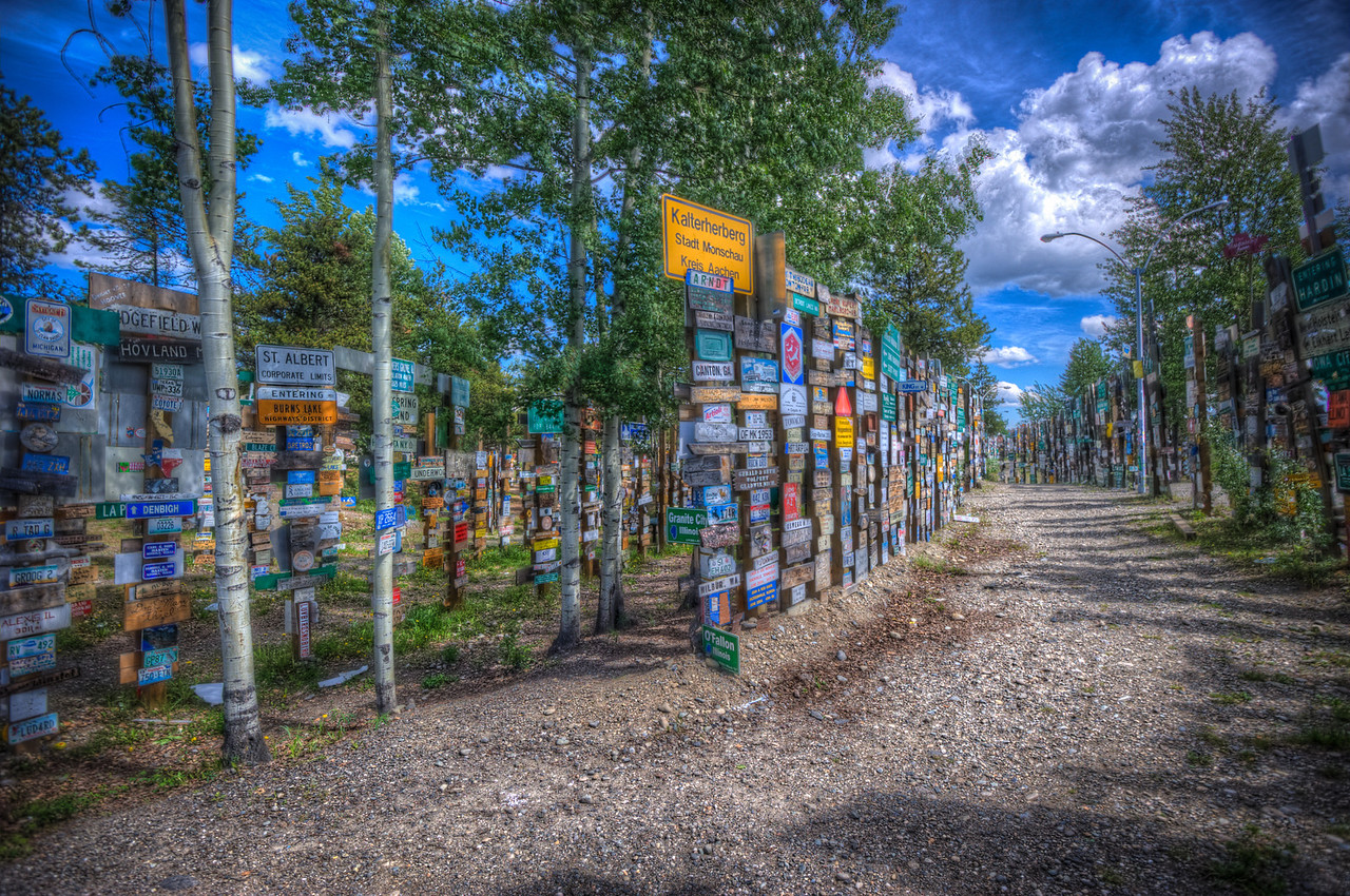 A 7 EV HDR photograph of the Signpost Forest in Watson Lake a popular stop along the Alaska Highway.  Taken with a Nikon d700, edited in Photomatix & Lightroom.