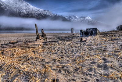 A 9 EV HDR photograph taken at Sandy Beach on Douglas Island Alaska, near Juneau Alaska.  Remnants of the Treadwell Gold Mine are visible in the background, as is Mt. Roberts the first mountain on the left across the Gastineau Channel.  Shot with a Sony Alpha a300, edited in Photomatix & Lightroom.