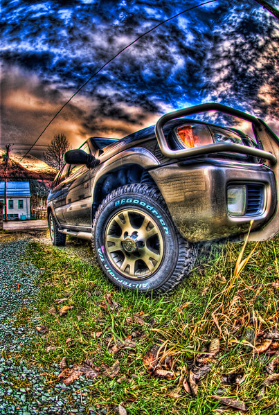 A 9 EV HDR photograph of the front corner of a SUV.  Taken with a Sony Alpha a300, edited in Photomatix, Topaz Adjust & Lightroom.