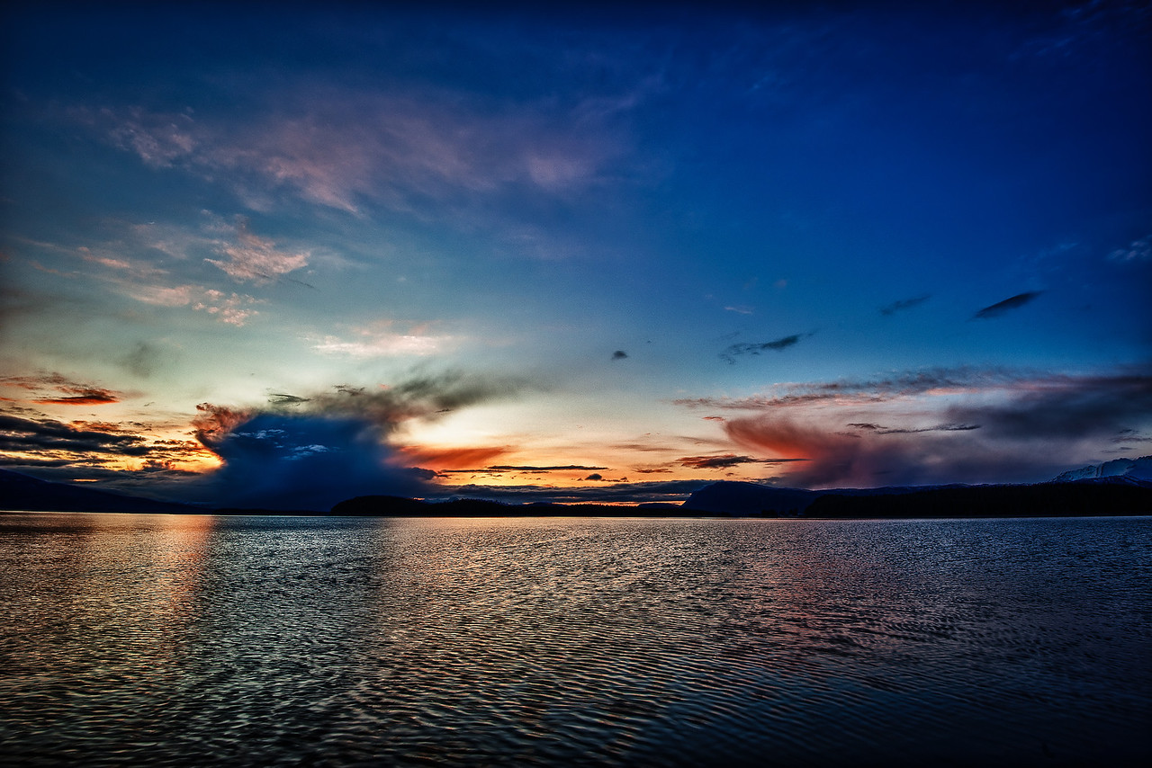 A 7 EV HDR Photograph of unusual clouds during a neat sunset from the North End of Douglas Island Alaska.  Taken with a Nikon d700, edited in HDR Efex Pro & Lightroom.