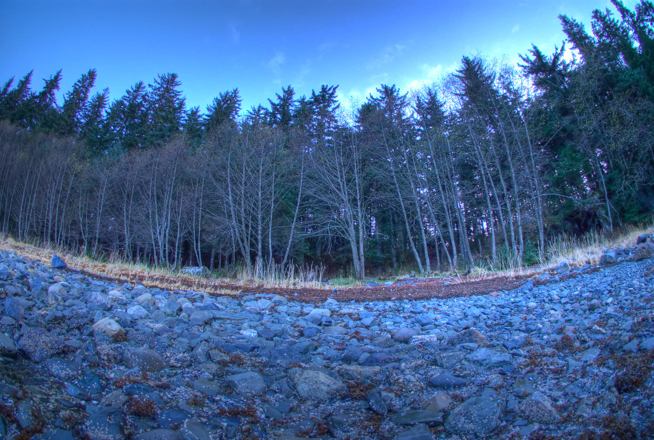 One of my early HDR photographs taken during the late evening summer sunset out False Outer Point on Douglas Island near Juneau Alaska.  Taken with a Sony Alpha a300, edited in Photomatix & Lightroom.