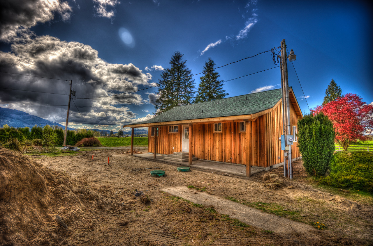 A 5 EV HDR Photograph of a house on a farm in Sedro Woolley Washington.  Taken with a Nikon d700, edited in Photomatix & Lightroom.