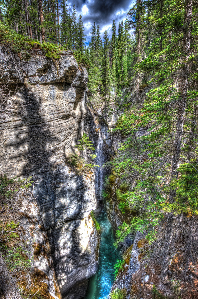 A 9 EV HDR Photograph of a narrowly carved canyon near Banff in Alberta.  Taken with a Nikon d700, edited in Photomatix & Lightroom.
